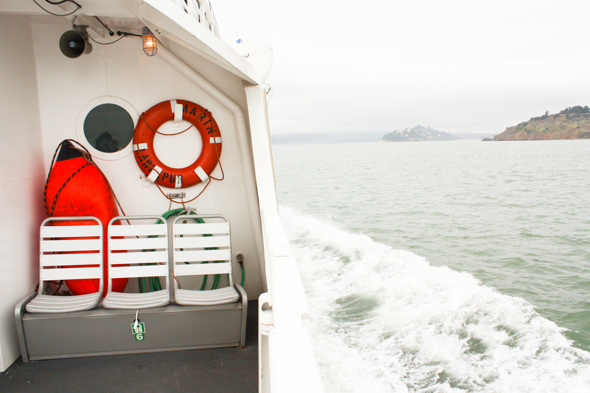 lifesaver on a boat on san francisco bay in the fog